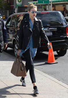 For an outing in SoHo, Gigi elevated black pants with oxfords and a luxe bag in tow.                  Image Source: Getty / Raymond Hall