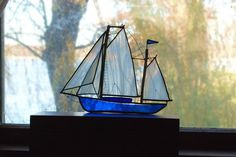 Vintage Stained Glass Sailboat Boat White Marble Masts Royal Blue Solder work  Nautical Sea Ocean Lake. $29.99, via Etsy.