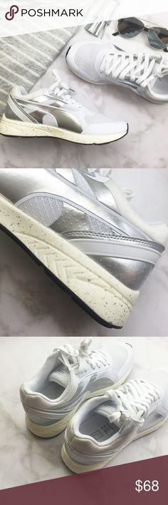Puma White and Metallic Sneakers Details:  • Size 8.5 • White and metallic fabric and synthetic upper • Speckled rubber sole • Brand new in box  07151604 Puma Shoes Sneakers