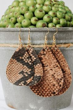 These gorgeous trendy snake skin leather earrings are the perfect compliment to your fall and winter outfits! You'll enjoy these lightweight leather earrings all day long and forget you're even wearing them! Click through to view even more teardrop leather earring options! #teardropleatherearrings #animalprintearrings #snakeskinleatherearrings #womensfashion