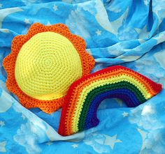Who can say no to sunshine and rainbows? This pair of soft little plushies are the perfect size for small fingers to grab and snuggle, and they do double duty as bright decorations for a child's room.