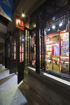 unique piece store facade shanghai SHIKUMEN community style chinese red color &brass design by Ydeco design