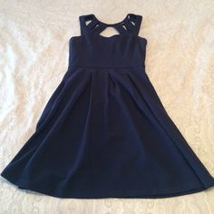 Navy Betsy Johnson Dress Pleated front and back and cutouts at the top front and back. Exposed zipper in the back. Super cute dress! Betsey Johnson Dresses