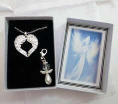 In the Arms of Angels Necklace Silver Plated Double Wings on silver plated trace chain with FREE White Angel Charm by JanbroCharmingGifts on Etsy Small Gift Boxes, Small Gifts, Angel Necklace, Pendant Necklace, Remembrance Gifts, White Angel, Organza Gift Bags, Novelty Gifts, Silver Necklaces