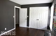 I love dark hardwood floors, dark grey walls, and white trim and doors...so classy