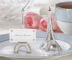 The French Eiffel Tower is a very romantic place. So for your Paris or French theme wedding or event decorate your banquet tables with these silver Eiffel Tower place card holders. Sold in sets of 4. $6.39 for 24 sets of more.