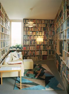 Home library. Lose the rug, the TV, and the tiled table (I loathe tiled tabletops), and I'll take it.