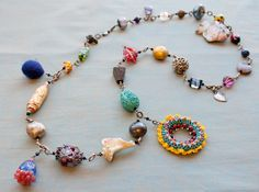 Birth Bead Necklace - (everyone offers a bead) blessingway. Great baby shower gift.... love this idea.