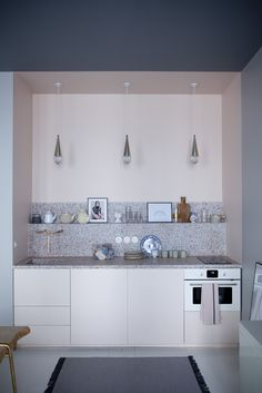 The compact kitchen with terrazzo counters at Chez Marie Sixtine, a guest apartment in Paris, Julie Ansiau photo | Remodelista