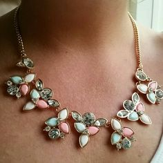 HPNWOT gorgeous statement necklace Absolutely gorgeous statement necklace adorned with flowers of mint green, pink and white. And don't forget about the rhinestones that really set this gold beauty off. Eye Candy of LA  Jewelry Necklaces