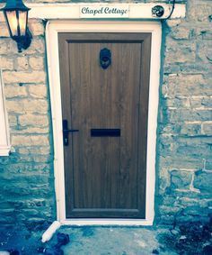 Our solid uPVC External Doors in Oak have a wonderfully traditional appearance and suit a range of our uPVC Windows, including Black Windows and White uPVC Windows.  #upvcfrontdoor #upvcfrenchdoors #upvcporchideas #upvcwindow #upvcdoor #upvc #upvcbackdoor