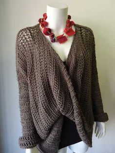 I've never tried making crochet or knit garments but I really like this one. Might have to give it a go if there is a pattern. Simply Elegant Crochet Sweater