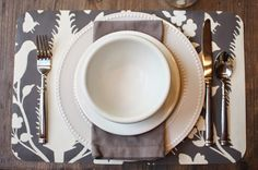 My Sweet Savannah ~~~ she covered dollar store placemats with wall paper ~~~ could work any style you're trying to achieve for your tablescape