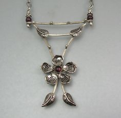 Flower trellis necklace with garnets handcrafted from sterling silver http://www.kryziakreationsstudio.com/products/garnet-flower-necklace-in-sterling-silver  $235.00