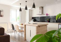 Un cocon familial. L'architecte lyonnais a crée une chambre supplémentaire dans une pièce à vivre d'un appartement à Fontaines sur Saône.Découvrez ses idées