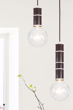 Nio by Gibas is an charmingly simple pendant made from powder-coated steel.