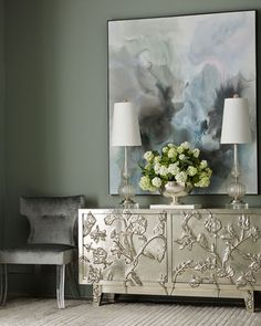 The unique front entry cabinet in a lustrous metallic finish makes a statement in luxe.