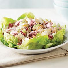 A new take on Waldorf salad. This one has sweet cherries and dried cranberries in addition to the classic apples and celery in a sweet creamy dressing. Serve it in lettuce cups for retro appeal.