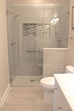 Elegant shower for a remodeled condo. A tub can almost always be removed and replaced with a glass enclosed shower. Will amp of the value of the property and give it a finished and sleek look.