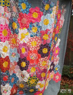 Hexy MF by ImAGingerMonkey, via Flickr  Bright hexagon flowers pop against a muted charcoal background fabric