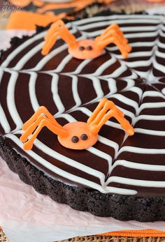 Spiderweb Chocolate Tart - a light chocolate tart with a chocolate ganache spiderweb and spiders made easily with candy melts!: