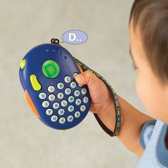 """Alphaberry-colors vary by Toysmith. $19.95. Toy is 3.25"""" x 2"""" x 4.25"""". Simply peel off the reusable stickers, slide tabs out, flip the reversible jacket over and wrap it back around the toy. 3 AAA batteries included. Ready for gift giving, comes with pretty patterned to-from gift tag with patented reversible gift box. From the Manufacturer                Push any button. The letter is displayed and read aloud. Turn wheel for 3 screen colors. Toggle between 4 musical styles of th..."""