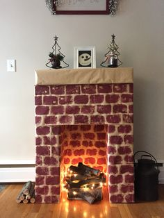 Cardboard fireplace, with real wood, and lights as fire. Love, love, love this. It was so easy to make. Wrapped in craft paper, blocks sponged on!! All done!