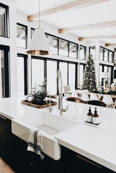 Yule style! Noel Christmas! Winter Solstice! gorgeous black and white kitchen and dining area and family room - ready for a Holiday Party! LOOK at the wonderful windows! And the white ceiling and white beams make the whole room look more visually cohesive and brighter and taller!