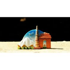 Multi-colored Delhi tourist fridge magnet with Lotus Temple, Qutub Minar and India Gate 3D designs. Material: Resin body, with a round magnet on the back side. Size: Approx 7 cms.