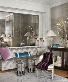 """Designer Benjamin Dhong transformed this living room by replacing cabinets with """"the relaxed elegance"""" of a custom banquette in velvet and antiqued mirrors. ➤ Discover the season's newest designs and inspirations. Visit us at http://www.wallmirrors.eu #wallmirrors #wallmirrorideas #uniquemirrors @WallMirrorsBlog"""