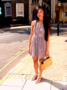 Love her look; the lovely lace dress in such pretty lavender, with her hair and strappy shoes. I feel the purse could be a little more whimsical and it'd be perfect ;)