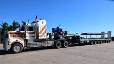 KENWORTH-T908. With a Drake 8-Axle Float.