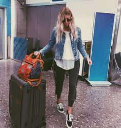 Perfect travel outfit - jean jacket, sneakers, joggers and a white sweater over a white shirt