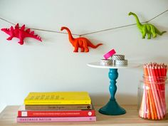 Possiblilities are endless: Whether you're planning a quirky party or want to spice up a bland area of your home, try your hand at this easy neon animal garland. From dinos to farm animals (or any plastic object), you can create your dream garland with little more than twine and spray paint. Courtesy of Erin Loechner at DesignForMankind.
