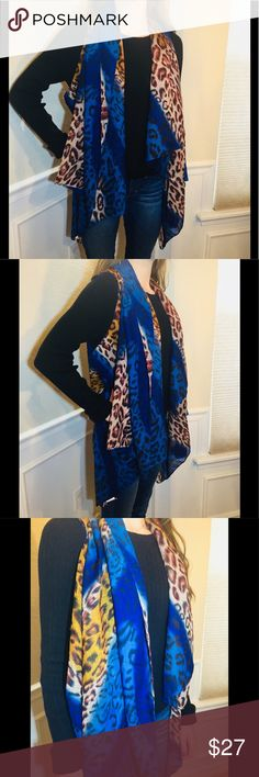 ⭐️NEW⭐️Convertible Scarf Vest ⭐️NEW⭐️Convertible Scarf Vest that can be worn several ways, including a scarf. Pretty Animal Print Bold Colors. One Size Fits Most. Accents By Lavello Accessories