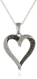 #blackdiamondnecklace Stunning and modern, the 10k White Gold Black-and-White Diamond Heart Pendant makes a lovely gift for someone you admire. Made from lush 10k white gold, the pendant measures 1.03 inches high and .67 inches wide. - See more at: http://blackdiamondgemstone.com/jewelry/necklaces/10k-white-gold-black-and-white-diamond-heart-pendant-necklace-13-cttw-ij-color-i2i3-clarity-18-com/