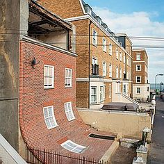 The British have a wonderful sense of humor, especially in bad circumstances. Artist Alex Chinneck reinvented a 19th century house in Margate (on the English Channel) that had been damaged by fire. Cool and striking.