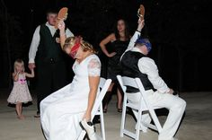 """HILARIOUS game: someone asks questions like """"who will do the dishes"""" or """"who is in charge of the remote"""" or """"who's parents will spoil grandkids"""". Blindfolded bride/groom holds up shoe of who they think so guests see how often they agree. We had preset questions the MOH asked then guests asked some after they got the idea."""