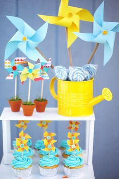 Kite and Pinwheel theme birthday party main dessert table decoration with pinwheels and cupcake with pinwheel toppers!