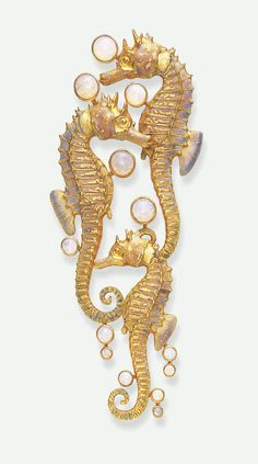 AN UNUSUAL ART NOUVEAU OPAL AND ENAMEL BROOCH, BY RENE LALIQUE - Comprising three sculpted opalescent enamelled sea horses, enhanced by effervescing cabochon opal bubbles, mounted in gold, circa 1900 | JV