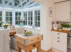 Cream Country Kitchen with Pretty Conservatory Dining Area