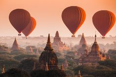 Bagan, Myanmar: Balloon is the best way to see the over 2,000 surviving pagodas, especially at sunrise or sunset, when the temple silhouettes glow in the mist of this once capital of the first Myanmar Empire.