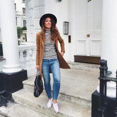 Mimi Ikonn   Stripped turtleneck top with light wash jeans, tan coat, black fedora, Stella McCartney Fabella shoulder bag, & white ASOS sneakers   OOTD