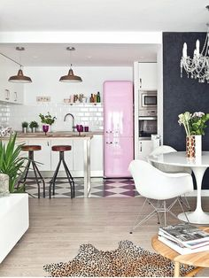 White kitchen and dining area with pops of colour