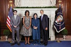 US President Barack Obama and First Lady Michelle Obama greets Foreign Minister Ms. Hina Rabbani Khar and Feroz Gulzar during the United Nations General Assembly reception at the New York Public Library.
