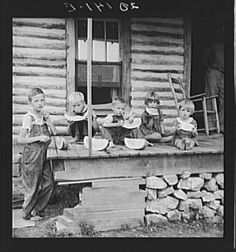 Millworker's children eating watermelon. Six miles north of Roxboro, Person County, North Carolina