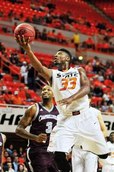 Oklahoma State guard Marcus Smart lays the ball into the basket during Oklahoma State's exhibition game versus Campbellsville