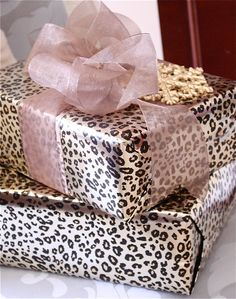 A pop of pink -- Leopard Gift Wrapping with pale pink bow #giftwrapping #emballagecadeau