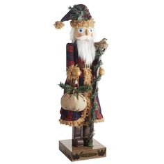 All of our nutcrackers are exclusive designs created by Pier 1 artists—first as a drawing, then handcrafted into a 3-D character. After that, we find all sorts of ways to richly embellish them, as demonstrated by our cape-clad Santa. He stands tall and proud with a cotton stocking cap, linen bag and natural sisal animals to keep him company on the long journey from the North Pole to your living room.