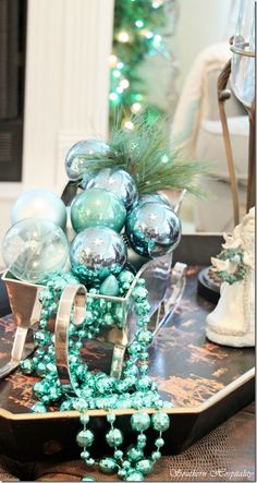 I would love a tree this color!  I'm crazy about non-traditional Christmas color schemes.